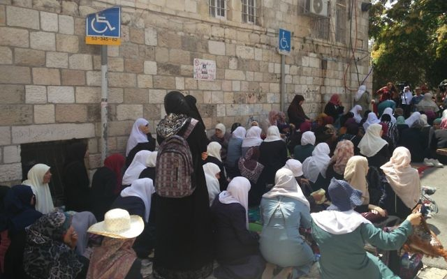 Muslim women, protesting Israeli security measures at the Lions Gate in the Old City of Jerusalem and refusing to enter the Temple Mount enclosure to reach the al-Aqsa Mosque inside, July 25, 2017. (Raou Wootliff/Times of Israel)