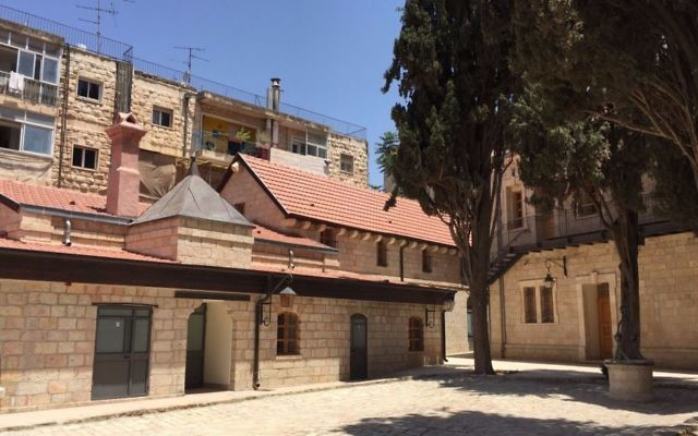 One of the restored buildings of Sergei's Courtyard, the late 1800s hostel for Russian pilgrims, now renovated to its former glory (Jessica Steinberg/Times of Israel)