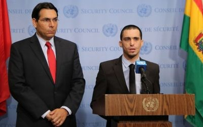 Israel's Ambassador to the UN Danny Danon and terror victim Oran Almog speak ahead of a Security Council meeting on July 25, 2017. (Dov Levi via Israel's mission to the UN)