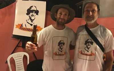 """Mickey Birnbaum (L) and his father Eli selling their """"Beer'nbaum beer at the Tekoa Beer Festival on July 6, 2017. (Jacob Magid/Times of Israel)"""