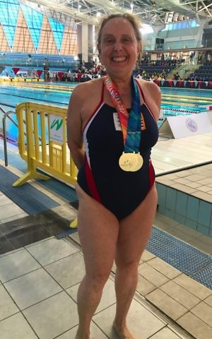 Jane Katz with the gold medals she won in the 200m freestyle and 100m backstroke women's Masters swimming races at the 20th Maccabiah Games, July 2017. (Courtesy)