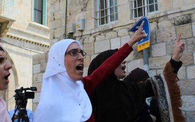 Muslim women, protesting Israeli security measures at the Lions Gate in the Old City of Jerusalem and refusing to enter the Temple Mount enclosure to reach the al-Aqsa Mosque inside,  July 25, 2017. (Raoul Wootliff/Times of Israel)