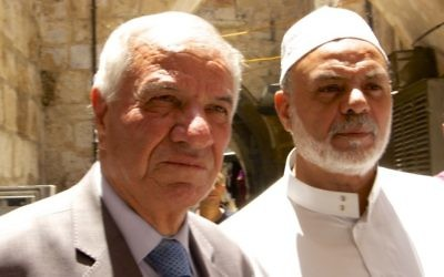 Sheikh Azzam Khatib, director of Islamic Waqf department (L) and Sheikh Yousef Abu Snaineh, Imam and Preacher of Al Aqsa Mosque at Lions Gate in the Old City of Jerusalem on July 19, 2017. (Dov Lieber/Times of Israel)