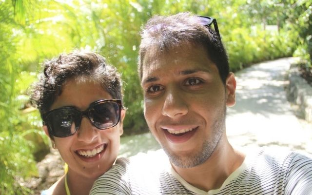 This August, 2015 self-portrait provided by Hesam Mostafavi shows him and his fiancee Mina Jafari on vacation in Playa del Carmen, Mexico. (Hesam Mostafavi via AP)