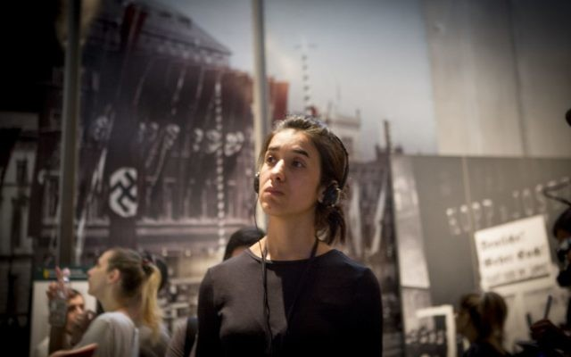 Nadia Murad, a Yazidi woman who escaped Islamic State captivity, tours Yad Vashem in Jerusalem on July 24, 2017 (Mickey Noam-Alon/IsraAID)