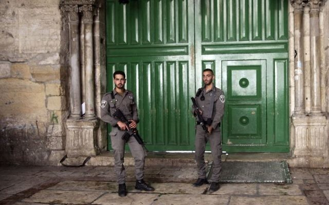 Israeli border police officers stand guard at the entrance to the Temple Mount compound in Jerusalem's Old City, Friday, July 14, 2017.  (AP/Mahmoud Illean)