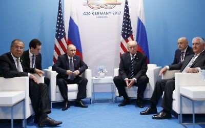 In this Friday, July 7, 2017, file photo, US President Donald Trump meets with Russian President Vladimir Putin at the G20 Summit, in Hamburg. Russian Foreign Minister Sergey Lavrov is at left, Secretary of State Rex Tillerson is at right. (AP Photo/Evan Vucci)