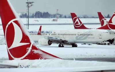 In this January 10, 2017, photo, Turkish Airlines aircraft are stationed at Ataturk International Airport covered in snow, in Istanbul, Turkey. (Faik Kaptan/Depo Photos via AP)