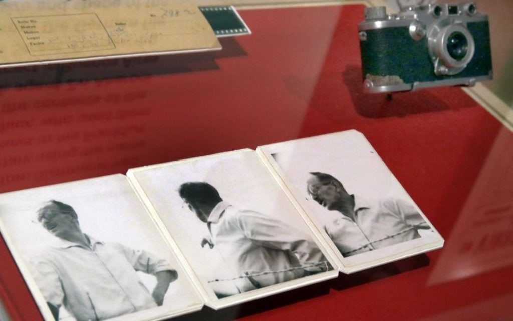 """Original negatives, the first photos of Adolf Eichmann in Argentina in 1960, and the Leica 35mm camera that was used, are displayed in the """"Operation Finale: The Capture & Trial of Adolf Eichmann"""" exhibit at the Museum of Jewish Heritage, in New York, Friday, July 14, 2017. (AP Photo/Richard Drew)"""
