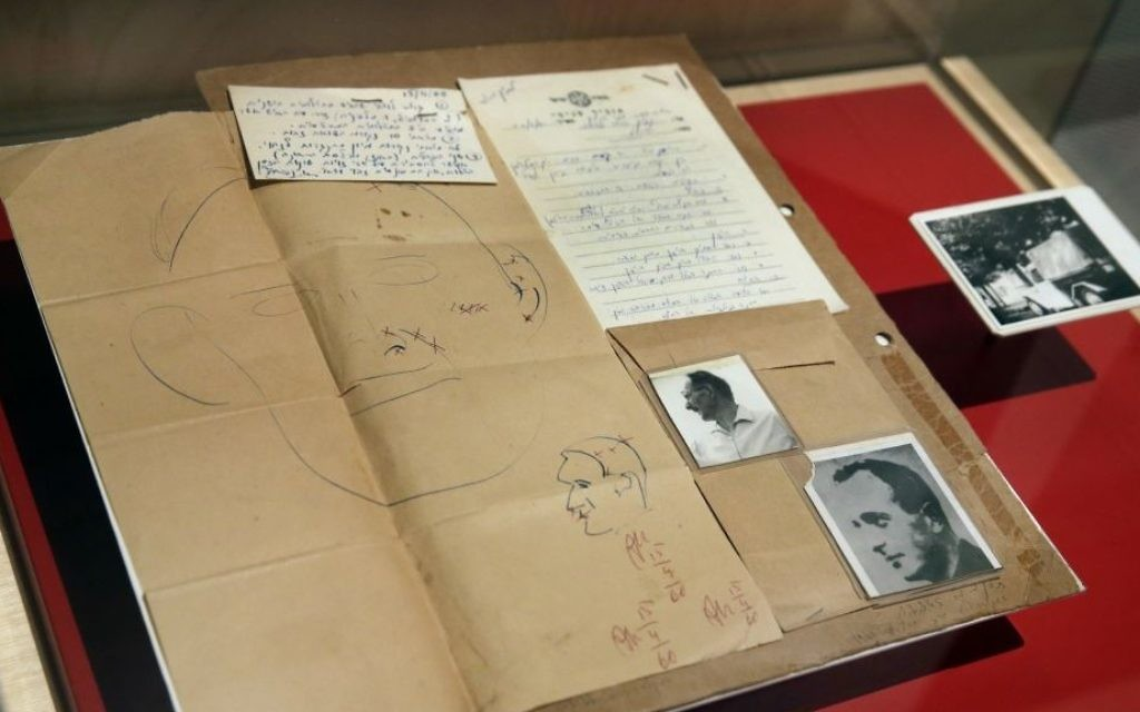 """The 1960 forensic crime lab file comparing photos of Adolf Eichmann in World War II and as Ricardo Klement in Argentina, are displayed in the """"Operation Finale: The Capture & Trial of Adolf Eichmann"""" exhibit at the Museum of Jewish Heritage, in New York, Friday, July 14, 2017. (AP Photo/Richard Drew)"""