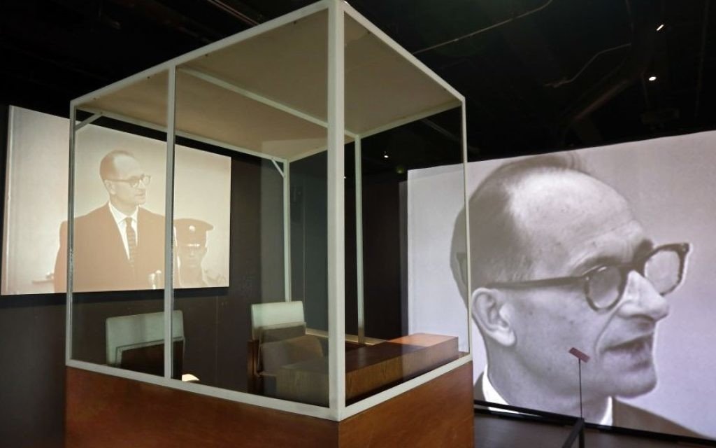 """The bulletproof glass booth in which Adolf Eichmann testified during his trial in Jerusalem District Court is displayed in the """"Operation Finale: The Capture & Trial of Adolf Eichmann"""" exhibit at the Museum of Jewish Heritage, in New York, Friday, July 14, 2017. (AP Photo/Richard Drew)"""