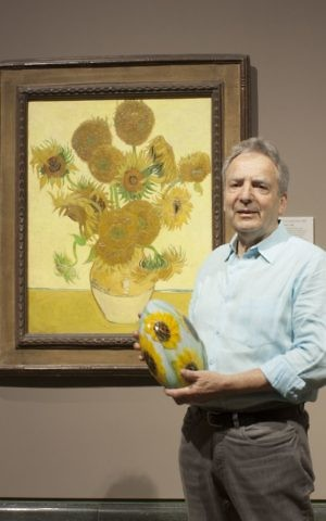Peter Layton next to Van Gogh's 'Sunflowers.' (The National Gallery)