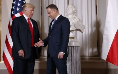 US President Donald Trump, left, is greeted by Polish President Andrzej Duda after arriving at the Royal Castle, Thursday, July 6, 2017, in Warsaw. (AP Photo/Evan Vucci)