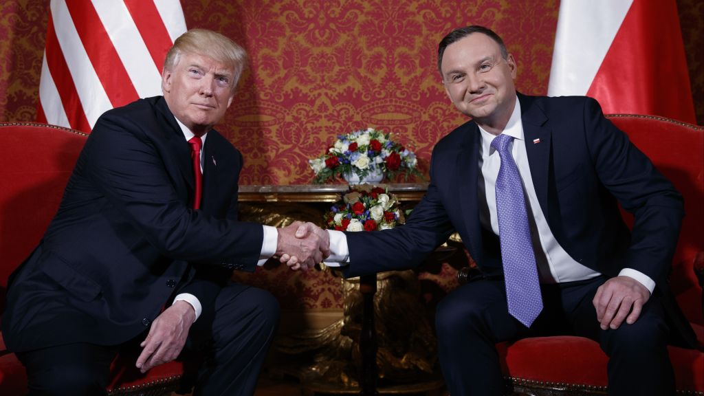 US President Donald Trump, left, and Polish President Andrzej Duda pose for photographers as they shake hands during their meeting at the Royal Castle, Thursday, July 6, 2017, in Warsaw. (AP Photo/Evan Vucci)