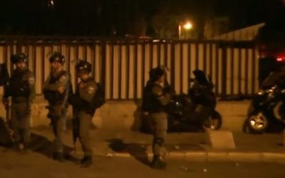 Screen capture from video showing border police seen during clashes with protesters in East Jerusalem overnight July 17, 2017. (YouTube/Ruptly TV)