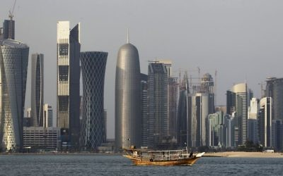 In this Thursday Jan. 6, 2011 file photo, a traditional dhow floats in the Corniche Bay of Doha, Qatar, with tall buildings of the financial district in the background. (AP/Saurabh Das, File)