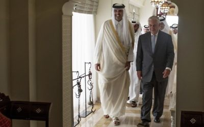 The Emir of Qatar, Sheikh Tamim Bin Hamad Al Thani, left, welcomes US Secretary of State Rex Tillerson to Sea Palace, his official residence, in Doha, Qatar, Tuesday, July 11, 2017. (Alexander W. Riedel/US State Department via AP)