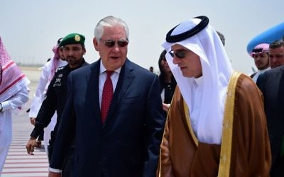 US Secretary of State Rex Tillerson, center left, is welcomed by Saudi Foreign Minister Adel al-Jubeir upon his arrival in Jeddah, Saudi Arabia, Wednesday, July 12, 2017.  (US State Department, via AP)