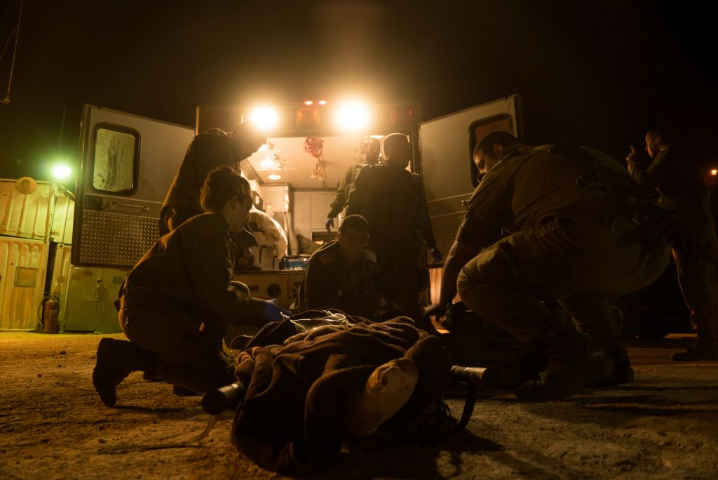 In this undated photo provided on July 19, 2017, IDF soldiers treat a wounded Syrian in the area of the Golan Heights. (IDF spokesperson)