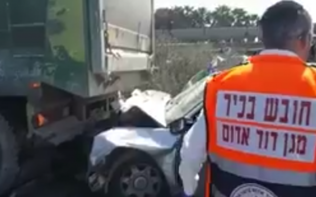 Rescue workers at the scene of a deadly car crash on Route 70 in northern Israel on July 17, 2017. (Screen capture: Twitter)