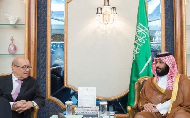 In this photo provided by the Saudi Press Agency, Saudi Crown Prince Mohammed bin Salman, right, receives French Foreign Minister Jean-Yves Le Drian in Jiddah, Saudi Arabia on Saturday, July 15, 2017. (Saudi Press Agency via AP)