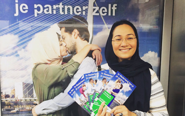 Shirin Musa handing out fliers in Rotterdam featuring images from the poster campaign on free choice of partners, May 25, 2017. (Courtesy of Femme for Freedom)