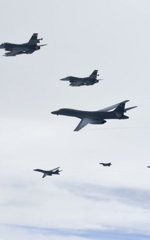 In this photo provided by South Korea Defense Ministry, US Air Force B-1B Lancer bombers, bottom left and third from top, fly with South Korean and US fighter jets over the Korean Peninsula, South Korea Saturday, July 8, 2017. (South Korea Defense Ministry via AP)