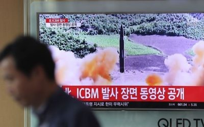 A man walks by a TV screen showing a local news program reporting about North Korea's missile firing at Seoul Train Station in Seoul, South Korea, Wednesday, July 5, 2017. (Lee Jin-man/AP)