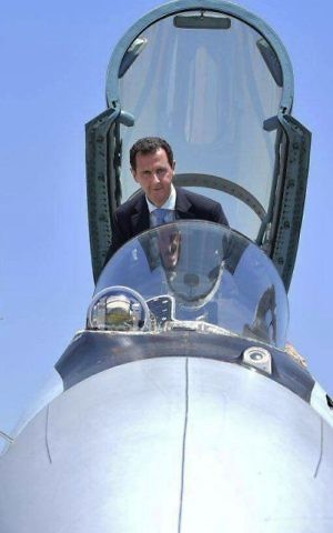 Syrian President Bashar Assad climbing into the cockpit of a Russian SU-35 fighter jet as he inspects the Russian Hmeimim air base in the province of Latakia, Syria, June 27, 2017 (Syrian Presidency via AP, File)