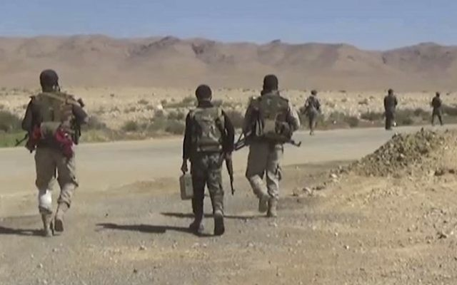 This frame grab from video released on May 26, 2017 and provided by the government-controlled Syrian Central Military Media, shows Syrian forces take up positions during fighting between government forces and Islamic State group militants in Homs province in central Syria (Syrian Central Military Media, via AP)