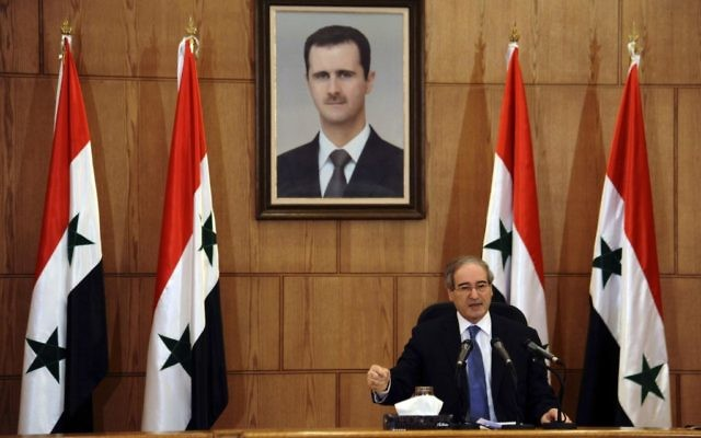 Syrian Deputy Foreign Minister Faisal Mekdad speaks during a press conference in Damascus, Syria, July 3, 2017. (SANA via AP)