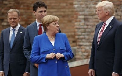 In this May 26, 2017 file photo, German Chancellor Angela Merkel (2nd right) talks with President Donald Trump, accompanied by European Council President Donald Tusk (1st left) and Canadian Prime Minister Justin Trudeau (2nd left) at a G7 meeting in Taormina, Italy (AP Photo/Evan Vucci, File)