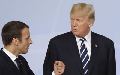 France's President Emmanuel Macron (L) talks with US President Donald Trump on the first day of the G-20 summit in Hamburg, Germany, July 7, 2017. (AP Photo/Michael Sohn, File)