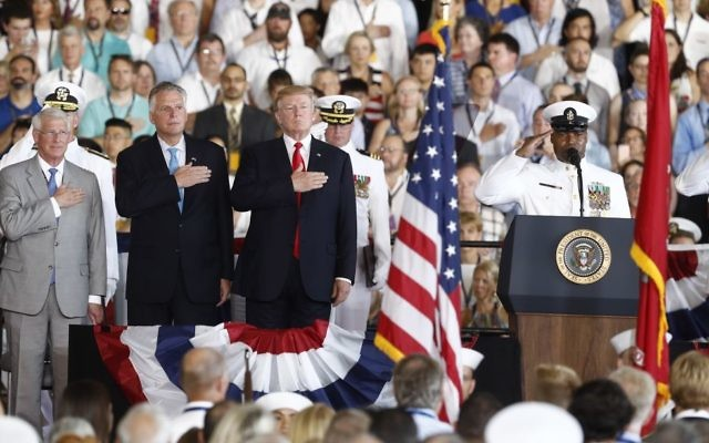 US President Donald Trump stands for the colors as he arrives during the commissioning ceremony of the aircraft carrier USS Gerald R. Ford (CVN 78) at Naval Station Norfolk, Va., Saturday, July, 22, 2017. (AP Photo/Carolyn Kaster)