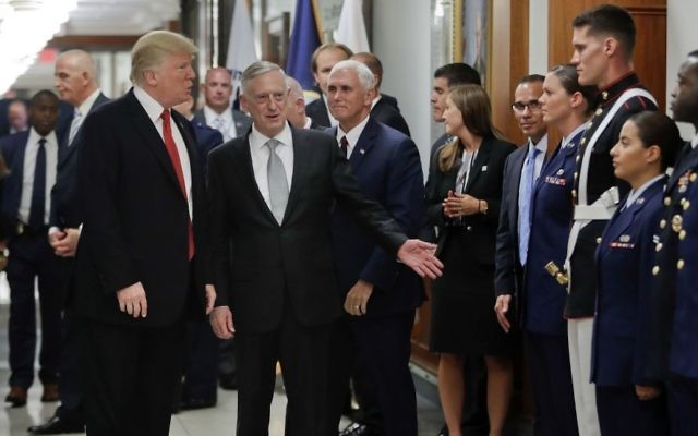US President Donald Trump and US Vice President Mike Pence walk with Defense Secretary James Mattis, center, to begin greeting military personnel during their visit to the Pentagon, Thursday, July 20, 2017. (AP Photo/Pablo Martinez Monsivais)