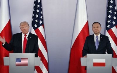 US President Donald Trump (left) speaks during a news conference with Poland's President Andrzej Duda at Royal Castle, Thursday, July 6, 2017, in Warsaw. (AP Photo/Evan Vucci)