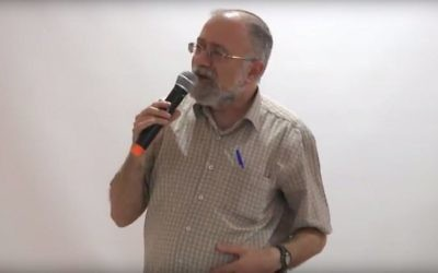Dr. Zohar Maor addresses a conference in memory of Rabbi Shimon Gershon Rosenberg (Shagar) in Jerusalem on June 15, 2017 (screen capture: YouTube)