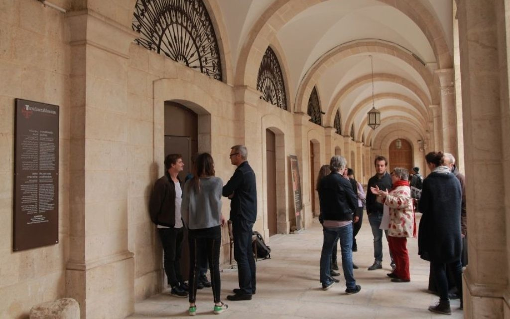 Visitors wait at the entrance of the Flagellation Monastery, off the Via Dolorosa in Jerusalem's Old City, for the Archaeology and Multimedia exhibition. (Courtesy of Tamschick Media)