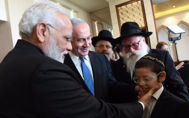 Indian Prime Minister Narendra Modi on July 5, 2017 meets with Moshe Holtzberg, the now 12-year-old son of two Chabad emissaries who were killed in a 2008 terror attack in Mumbai. (Haim Tzach, GPO)