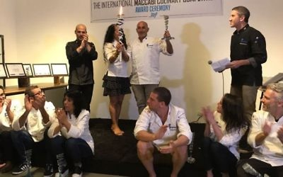 The gold medal-winning team for the culinary competition: Standing, L-R is Team Australia, Ido Zarmi, Ronit Robbaz, Zohar Flantz, Michael Solomonov. Sitting L-R is Team Israel: Osama Dalal, Shalom Ghenesh and Lamees Salem and Team USA: Yehuda Sichel, Lissadel Cohen Serrins and Lior Lev Sercarz. (Courtesy Sara Weinstein)
