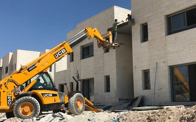 A photograph of the construction work being done for a new neighborhood in the Ma'ale Amos settlement on June 18, 2017. (Jacob Magid/Times of Israel)