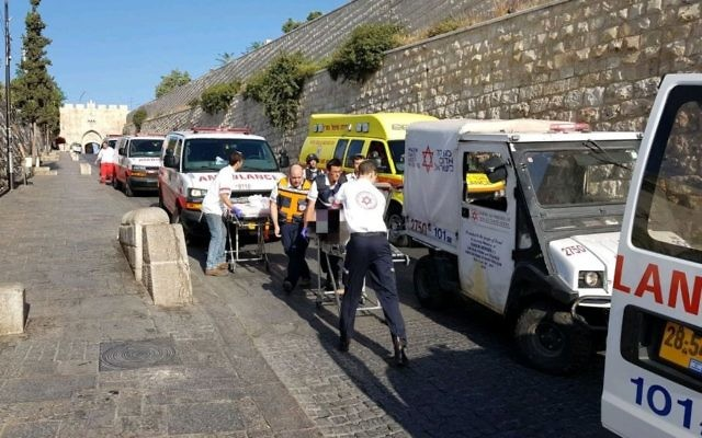 Medics treat victims of a shooting attack on the Temple Mount in Jerusalem's Old City on July 14, 2017. (Magen David Adom)