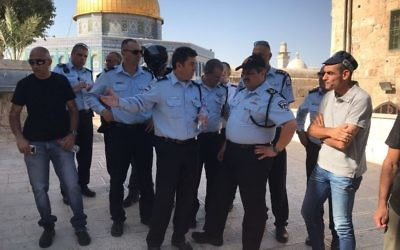 Israel Police Commissioner Roni Alsheich, center-right, speaks with Jerusalem Police chief Yoram Halevi, center, on the Temple Mount, following a terror attack nearby on July 14, 2017. (Israel Police)