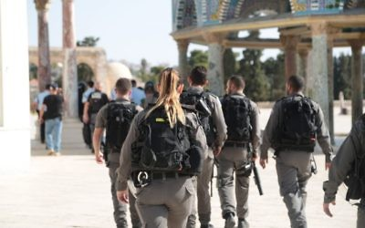 Border Police officers walk on the Temple Mount after a shooting attack in the area left three people injured, two of them seriously, on July 14, 2017. (Israel Police)