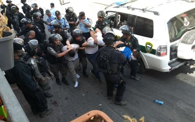 Illustrative. Israeli security forces arrest a Palestinian rioter in Wadi Joz, near the Old City of Jerusalem, July 21, 2017. (Judah Ari Gross/Times of Israel)