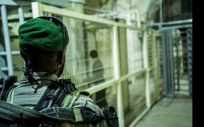 Illustrative: A Border Police officer stands guard at a checkpoint in the West Bank city of Hebron. (Israel Police)