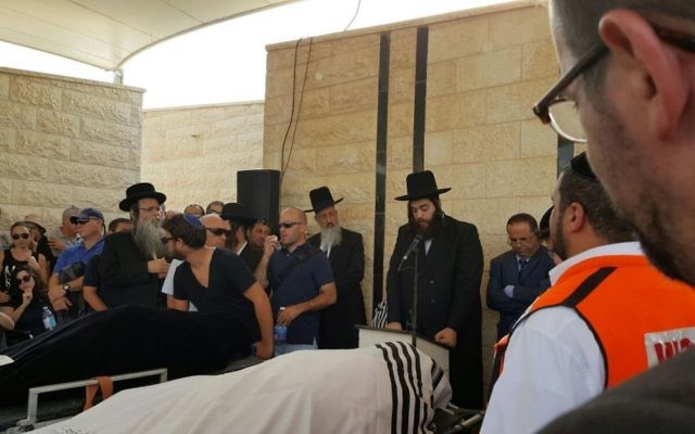 Thousands of mourners attend the funeral of Yosef Salomon, 70, and his two children Chaya, 46, and Elad Salomon, 36, who were stabbed to death in their home by 19-year-old Palestinian Omar al-Abed, July 23, 2017. (Courtesy)