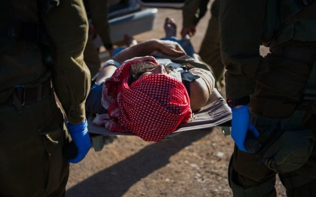 In this undated photo provided on July 19, 2017, IDF soldiers evacuate a wounded Syrian in the area of the Golan Heights. (IDF spokesperson)