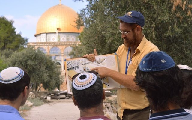 On a tour of the Temple Mount, Yehuda Glick shows religious Jews a diagram of the Jewish temple, which once stood where the golden Dome of the Rock stands today on Sepetember 17, 2013 in Jerusalem Israel. (Photo by Christa Case Bryant/The Christian Science Monitor via Getty Images via JTA)