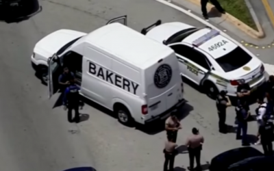 An abandoned van used in a bank robbery that belongs to the Kosher Miami bakery Zak the Baker. (Screen capture: YouTube)